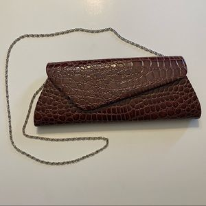 Faux snakeskin brownish purple clutch with strap